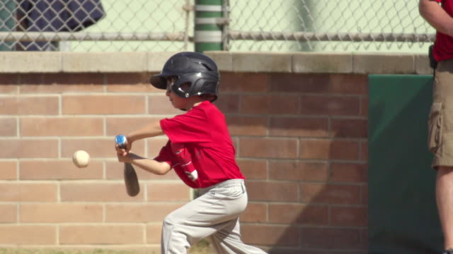 Kids playing little league baseball. - Super Slow Motion - filmed at 240 fps