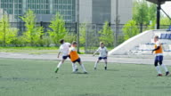 Kids training professional soccer