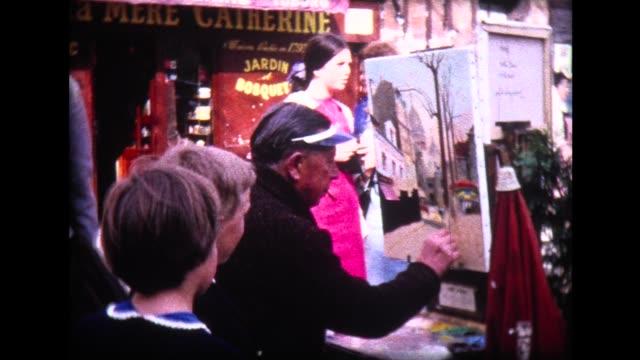1965 kids watch street painter near Montmartre