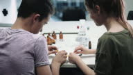 2 kids working with chemist set