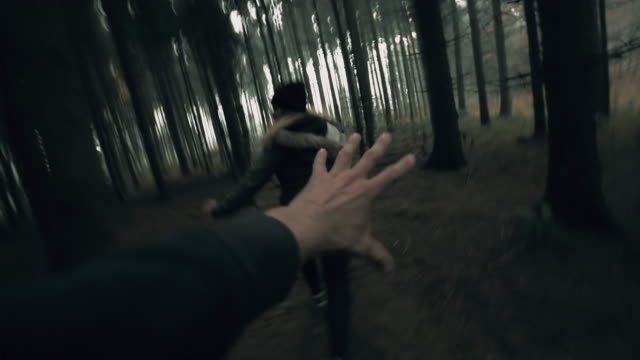 POV Killer chasing a woman through the forest
