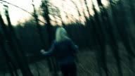 HD: Killer Chasing Young Woman In The Forest