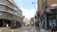 Accused cyclist gives evidence Shoreditch Old Street Close shot of 'Wait' sign at pedestrian crossing Traffic along Old Street Old Bailey Reporter to...