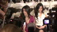 Kim Kardashian and Kourtney Kardashian at the Los Angeles Fashion Week D'Amore by Marceau at Los Angeles CA