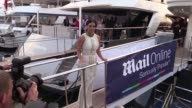 Kim Kardashian on the boat at Dailymail boat party in Cannes during the 2014 Cannes Lions Festival Kim is wearing a tight white cord made dress on...