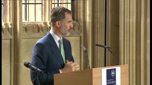 Lunch and speech at Divinity School Oxford INT King Felipe VI speech SOT King Felipe and Queen Letizia seated with others at lunch / Guests mingling...