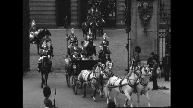 King Bhumibol and Queen Srinagarindra leave Buckingham Palace in a carriage accompanied by the Household Cavalry