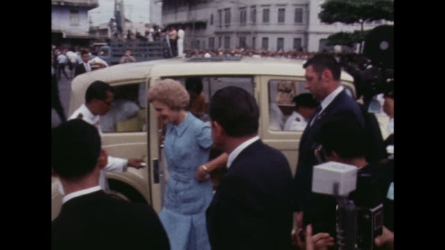 King Bhumibol Queen Srinagarindra and Pat and Richard Nixon disembark from cars during their official visit to Thailand