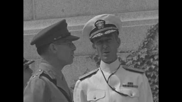King George II of Greece stands with Rear Admiral John Beardall Superintendent of the United States Naval Academy during a visit to campus during...