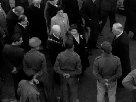 King George VI and Queen Elizabeth chat to builders on the new Lansbury housing estate in Poplar