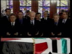 Funeral POOL JORDAN Amman EXT Soldiers carrying flag draped coffin of King Hussein of Jordan along Crowd of mourners following coffin President Bill...