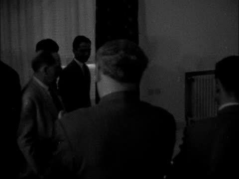 King Hussein presents his fiancee Toni Gardiner JORDAN Amman INT Hussein of Jordan along down staircase with fiancee Antoinette Gardiner Gardiner and...