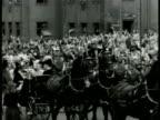 King of Sweden Oscar Gustaf Adolf Queen Victoria of Sweden riding horse drawn carriage through parade Stockholm Sweden