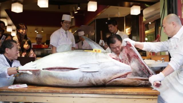 Kiyoshi Kimura president of Kiyomura K K poses with a tuna at a Sushi Zanmai sushi restaurant in Tokyo Japan on Monday Jan 5 Kiyoshi Kimura president...