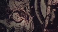 "Kizil Caves Mural ""Mara's Assault on the Buddha"" Demons Buddha and girls Close Shot Pan Right"