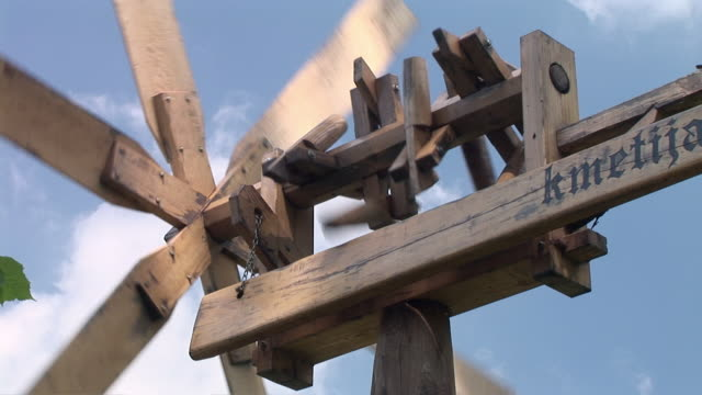 CU, LA, Klopotec (wooden mechanical device similar to windmill used as scarecrow in vineyards) spinning against sky, Haloze, Stajerska, Slovenia