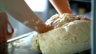 Kneading a dough.