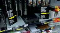 Jacqui Smith supermarket visit Various shots of kitchen knives on display in Asda supermarket/ sign on knife shelves 'We are working to prevent the...