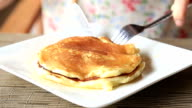 HD: knife sliced pancakes are on the plate.