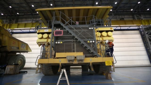 Komatsu Ltd dump trucks sit inside the truck shop at the Oyu Tolgoi coppergold mine jointly owned by Rio Tinto Group unit Turquoise Hill Resources...
