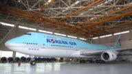 A Korean Air Lines Co passenger aircraft stands inside a hangar at Incheon International Airport in Incheon South Korea on Monday Feb 27 Signage with...
