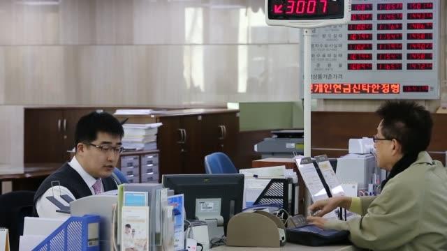 Korean Banks Kookmin Bank signage interior customers bankers tellers Korean Banks Kookmin Bank on February 06 2013 in Seoul South Korea