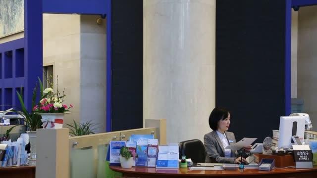 Korean Banks Woori Bank interior customers banker Korean Banks Woori Bank on February 06 2013 in Seoul South Korea