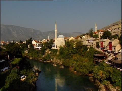 Koskin-Mehmed Pasha's Mosque and minaret beside Neretva River Mostar