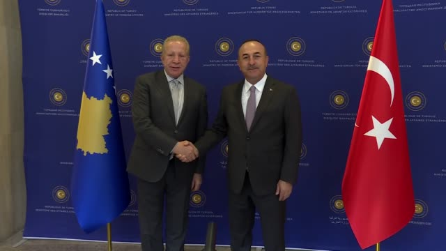 Kosovo Foreign Minister Behgjet Pacolli meets with Turkish Foreign Minister Mevlut Cavusoglu in Ankara Turkey on October 26 2017