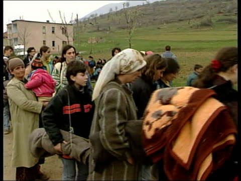 Refugees ITN TGVs Queue of vehicles to Kosovo/Albanian border GVs Refugees towards thru town carrying possessions James Ron interviewed SOT What...