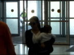 Kourtney Kardashian Scott Disick and Mason Disick at JFK Airport at the Celebrity Sightings in New York at New York NY