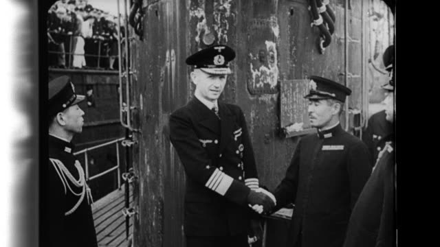 Kriegsmarine Admiral Karl Doenitz CommanderinChief of Nazi German Submarine Fleet and other German submariners greet the officers and crew of a...