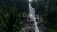 Krimmel Waterfall crashes through an evergreen forest in the Swiss Alps. Available in HD.