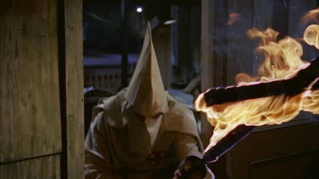 CU ZO  ku klux klan men with  burning cross wrecking small printing office