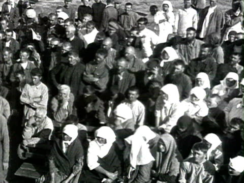 MS Kulaks listening to bolshevik representative flags banners and Lenin portrait trial of local kulak Chernov AUDIO/ Russia