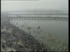 Allahabad Crowd of Hindu pilgrims away to cross bridge over Ganges on day before most sacred day of Kumbh Mela festival GV Pilgrims along bridges...