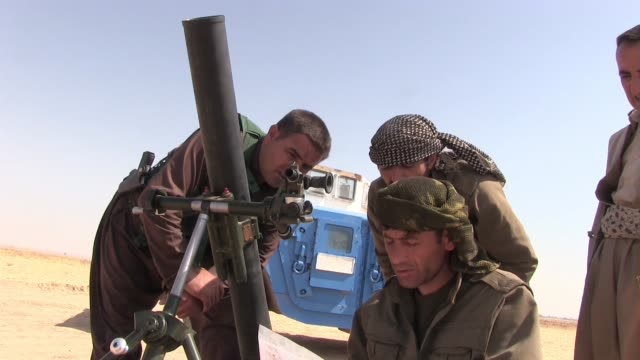 PKK Kurdish fighters prepare to launch mortar shell into ISIS position near the city of Kirkuk in northern Iraq