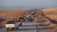 Kurdish peshmerga engineers pile on earth on a road to Mosul stop Islamic State suicide bombers attacking Kurdish positions during the battle to...