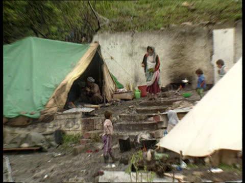 Kurdish situation IRAQ MS Kurdish tent settlement ZOOM MS Kurdish man woman and children towards CMS Woman with baby along in mountains PAN RL
