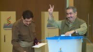 Kurdistan Democratic Party members Fazil Mirani and Hoshyar Zebari cast their ballots in the Kurdish independence referendum at a polling station in...