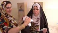 Kurds vote in historic referendum on independence IRAQ Erbil INT Woman dipping her finger into indelible ink before casting her vote in a referendum...