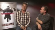 INTERVIEW Kurt Russell Tim Roth on Kurt Russell being chained to Jennifer Jason Leigh not talking at The Hateful Eight junket on December 10 2015 in...
