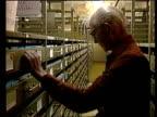 Kurt Waldheim investigation Edward Stourton reports Washington National Archive TCMS Hands operating microfilm equipment TCMS Pages passing RL under...