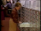 Kurt Waldheim investigation TX National Archive MS SIDE woman at open drawer in line of filing cabinets CMS SIDE man closing filing drawer MS SIDE...
