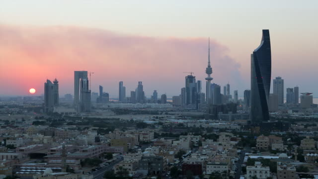 Kuwait, Kuwait City, elevated view over the modern city skyline at dusk