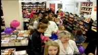 Kylie Minogue writes children's book ENGLAND London Oxford Street Waterstones INT High angle shot of parents with children in bookshop filled with...