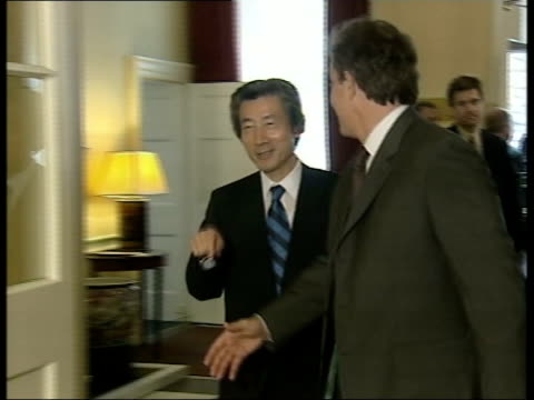 Britain and Japan discussions ITN ENGLAND London Downing Street Tony Blair MP shaking hands with Junichiro Koizumi outside No10 ZOOM IN GV Japanese...