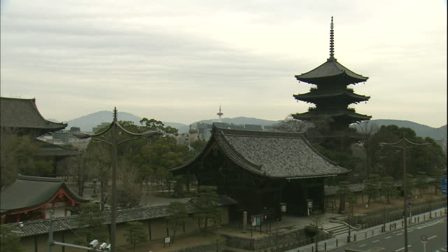 Kyoto Tower looms over the five-storied pagoda of To-ji Temple in Kyoto.