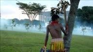 La policia disperso el martes con gases lacrimogenos una manifestacion pacifica contra el Mundial 2014 protagonizada por indigenas y miembros de...