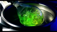 Laboratory glass with liquid in Slow Motion